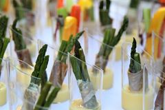 Buffet table with  cut vegetable hors d`oeuvres on a white tablecloth Stock Photos