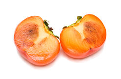 Cut persimmon. Two halves of cut ripe persimmon. Isolation Stock Photography