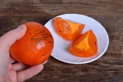 Cut persimmon Royalty Free Stock Photos