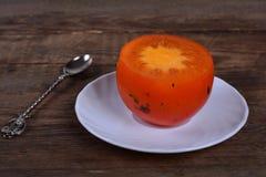 Cut persimmon Royalty Free Stock Photo