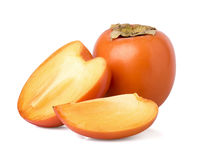 Cut persimmon. On a white background royalty free stock images