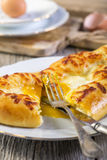 Cut pie with cheese and egg yolk. Stock Photography