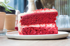 Cut a piece of cake Red Velvet royalty free stock photography