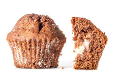 Cut a piece of chocolate cake with a close muffins closeup crumbs near isolated Stock Photos