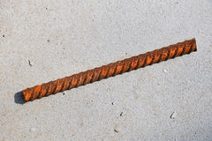 Cut piece of corroded stained rusty metal armature fitting Stock Image