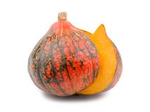 Cut a piece from a ripe and useful pumpkin. Isolated on white background. Cut a large piece from a ripe and useful orange pumpkin, vitamins. Isolated on white Royalty Free Stock Photography