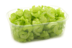 Cut pieces of celery in a plastic container Royalty Free Stock Images