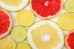 Cut pieces of different citrus fruits. The cut pieces of different citrus fruits stock images
