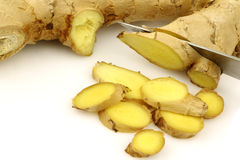 Cut pieces of fresh ginger with a knife Royalty Free Stock Image