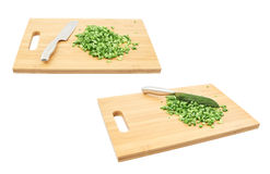 Cut in pieces green onion over cutting board Royalty Free Stock Images