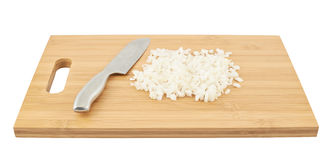 Cut in pieces onion over cutting board Royalty Free Stock Photo