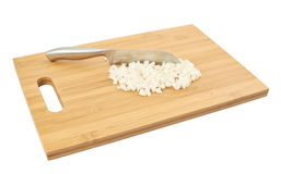 Cut in pieces onion over cutting board Royalty Free Stock Image