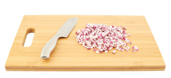 Cut in pieces red onion over cutting board Royalty Free Stock Image