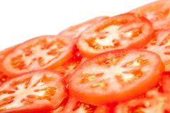 Cut pieces of tomatoes. Close-up on white Stock Photo