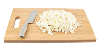 Cut in pieces white cabbage over cutting board Stock Photos