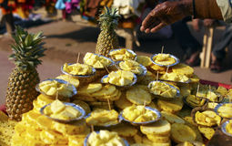 Cut pineapple fruit on the food stall Royalty Free Stock Photography