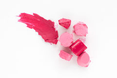 Cut pink lipstick with smear of one, flat lay Stock Images