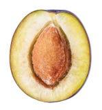 Cut plum fruit isolated on white background Royalty Free Stock Photos