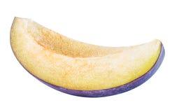 Cut plum fruit isolated on white background Stock Photos