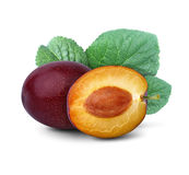 Cut plum with leaf  on white Royalty Free Stock Photography