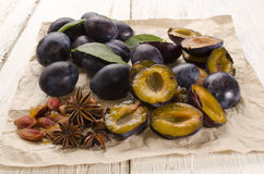 Cut plums and star anise Royalty Free Stock Images