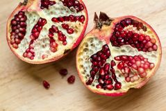 Cut pomegranate Stock Images