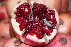 Cut the pomegranate fruit compared Stock Photography