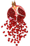 Cut the pomegranate with scattered grain Royalty Free Stock Images
