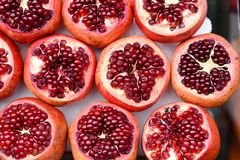 Cut Pomegranates From Above. royalty free stock photography