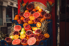 Cut pomegranates and grapefruits on a Turkish market Royalty Free Stock Photo