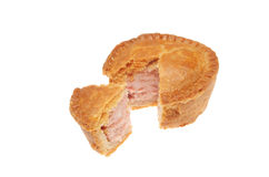 Cut pork pie. Pork pie with wedge cut out on white Royalty Free Stock Photography