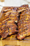 Cut pork ribs. On a wooden board royalty free stock photo