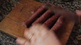 Cut pork sausage stock video footage