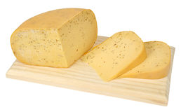 Cut portions of cumin-flavoured Gouda cheese Royalty Free Stock Photos