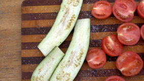 Cut into portions of vegetables are on board stock video footage