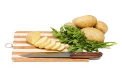 The cut potato on a chopping board Royalty Free Stock Image