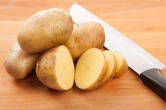 Cut potatoes on cutting board Royalty Free Stock Photos