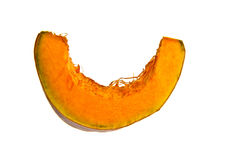 Cut Pumpkin Against A White Background Royalty Free Stock Photography