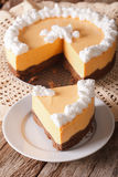 Cut pumpkin cheese cake decorated with whipped cream close-up. v Royalty Free Stock Image