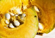 Cut pumpkin in close up. Horizontal image Stock Image