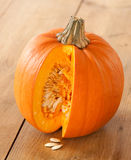 Cut Pumpkin Exposing Seeds Stock Photos