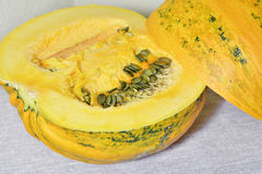 Cut pumpkin with seeds Royalty Free Stock Image