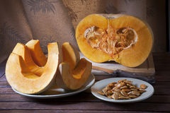 Cut the pumpkin on the table. Still life Stock Image