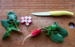 Cut radish on wooden cutting board. Cut radish on wooden cutting board Stock Photo