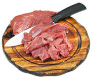 Cut raw meat and ceramic knife on cutting board Royalty Free Stock Images