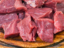 Cut raw meat on cutting board close up Royalty Free Stock Photo