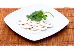 Cut raw mushrooms and parsley Royalty Free Stock Photos