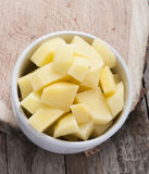 Cut raw potatoes in bowl Royalty Free Stock Images