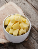 Cut raw potatoes in bowl Stock Photos