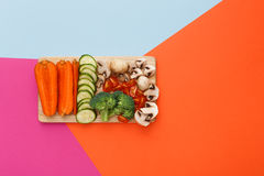 Cut raw vegetables on wooden board, healthy food. Cooking vegetarian diet top view. Healthy food, copy space. Ingredients for salad or soup - mushroom, cherry Stock Photo